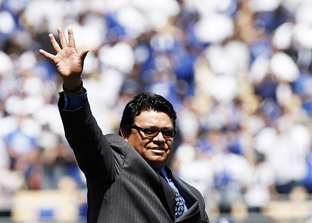 Former Los Angeles Dodgers pitcher Fernando Valenzuela, waving to the crowd, is the logical choice to be the team's next manager. (AP Photo/Kevork Djansezian)