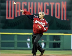 President George W. Bush throws out the first pitch at a Washington Nationals game.