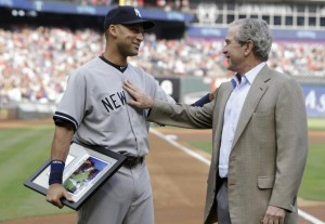 Yankee legend Derek Jeter gets a congratulatory pat during his finale game in Texas from President George W. Bush.