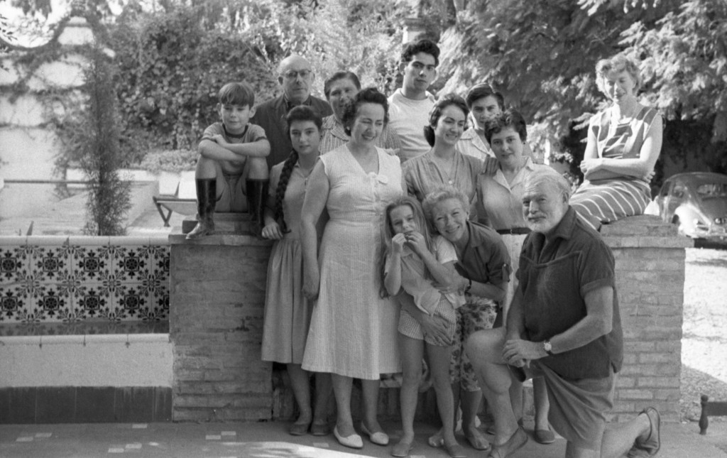 Teo Davis, top left on the wall with his young sister Nena and household staff from his family home, La Consula, and its 1959 guests, Ernest and Mary Hemingway. (Photo courtesy of the Estate of Teo Davis)